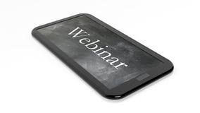 Webinar written on tablet, with blackboard on screen Royalty Free Stock Image