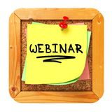 Webinar. Yellow Sticker on Bulletin. Stock Image