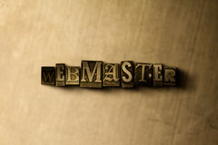 WEBMASTER - close-up vintage sujo da palavra typeset no contexto do metal ilustração royalty free