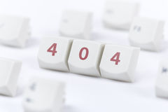 Webpage not found concept. Concept of computer keyboard button with 404 web page error message sign on white background Stock Photography