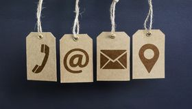 Website Contact Us Icons On Paper Tags Stock Images