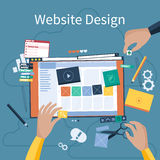 Website design. Concept. Hands that design web site with different blocks. Tablet pc interface. Big Touch pad buttons in flat design style Stock Photo