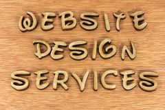 Website design services online wood letters. Computer website design services education educational learning small business message wooden background sign Royalty Free Stock Photo