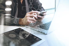 Website designer working digital tablet and computer laptop  wit Stock Photo