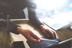 Website designer working digital tablet dock keyboard and comput Royalty Free Stock Image