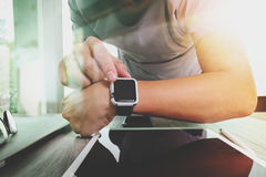 Website designer working with smart watch and digital tablet Royalty Free Stock Photo