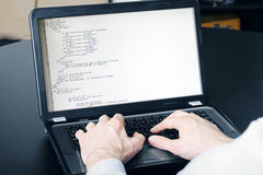 Website development process - programmer writing code Royalty Free Stock Images