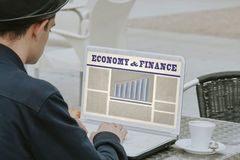 Website of economy and finance. Man by consulting the website of economy and finance on the laptop Stock Photography