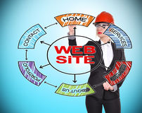 Website. Engineer woman drawing website concept on blue background Royalty Free Stock Photography