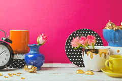 Website header design with colorful objects over pink background Royalty Free Stock Photography