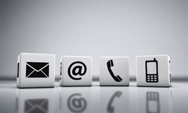 Web Contact Us Icons On Cubes Stock Images