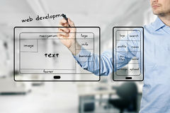 Website and mobile app development. Designer with marker stock photos