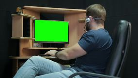 Male programmer relaxed working with code stock footage