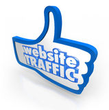 Website Traffic Thumb Up Increase Visitors Online Reputation. Website Traffic words on blue thumb's up symbol to illustrate increasing online visitors Stock Photography