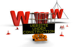 Website under construction. Concept of building website with letters www being built and painted, traffic sign, barriers and cones spread accross Royalty Free Stock Photography