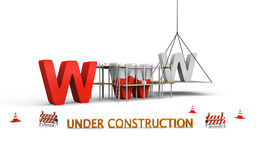 Website under construction. Simple website under construction concept with letters www being built and painted red, with traffic barries and cones spread across Royalty Free Stock Images