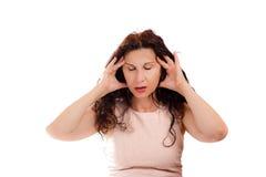 Wechseljahresfrau mit Kopfschmerzen Stockfotografie