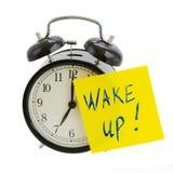 Wecker mit wachen auf! Anmerkung Stockbild