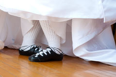Wed Irish I. Feet in ghillies surrounded by wedding dress Royalty Free Stock Photo