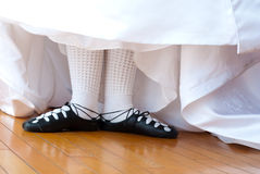 Wed Irish II. Feet in ghillies surrounded by wedding dress Royalty Free Stock Photography