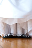 Wed Irish III. Feet in ghillies surrounded by wedding dress Royalty Free Stock Image