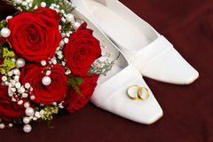 Weddin concept with rings flowers and shoes Royalty Free Stock Photos