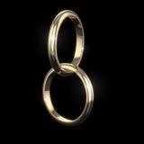 Wedding золотистые кольца - на черноте Стоковые Фото