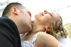 Wedding. Kiss of bride and groom Stock Photography