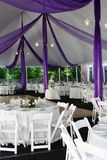 Wedding. Outdoor wedding reception with dance floor and white tables and chairs Royalty Free Stock Photos