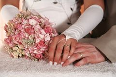 Wedding. Flower with hands with rings Royalty Free Stock Photos