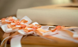 Wedding. A wedding guestbook and ribbons on a table stock images