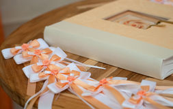 Wedding. A wedding guestbook and ribbons on a table stock image