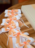 Wedding. A wedding guestbook and ribbons on a table royalty free stock images