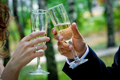 Wedding. Theme, the hand with a glass of champagne Stock Photo