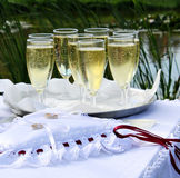 Wedding. Rings and champagne on a table Royalty Free Stock Photos