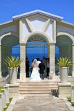 Wedding. Romantic wedding ceremony at glass church, blue ocean with clear blue sky as background,Island Bali,Indonesia royalty free stock photography
