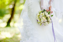 Wedding. Bouquet in the hands of the bride Stock Image