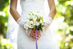 Wedding. Bouquet in the hands of the bride Stock Photography