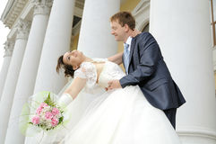 Wedding. Cutie happy married  couple  hot embrace  on architecture background, smile Stock Image