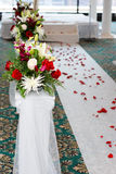 Wedding. Religious wedding ceremony, nice wedding bouquet is right next to the final aisle to marriage royalty free stock photography