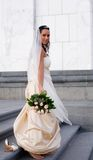 At the wedding. Bride walking barefoot by the church stock image