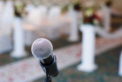 Wedding. Religious wedding ceremony, microphone is ready and rosy path to the marriage in the background stock photo