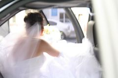 Wedding. The bride in a white dress leaving the car Royalty Free Stock Images