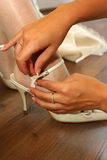 Wedding. The wedding shoes on bride Stock Photography