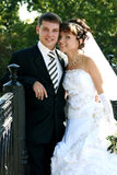 Wedding. Newly married together in a photo pose Royalty Free Stock Image
