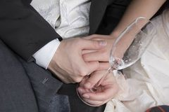 Wedding. Two hands and glass Royalty Free Stock Image