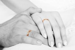 Wedding. S rings on the hands of newly-weds Stock Photos