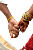 Wedding. Joint hands of just married hindu couple with clipping path Royalty Free Stock Image