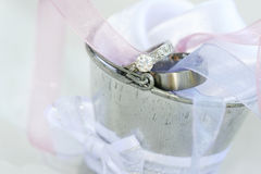 Wedding #5. Wedding and engagement rings in a silver tin bucket. Shallow D. O. F ? Rings in focus, foreground and background out of focus stock image