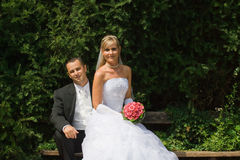 Wedding. Couple sitting in a park Royalty Free Stock Photo